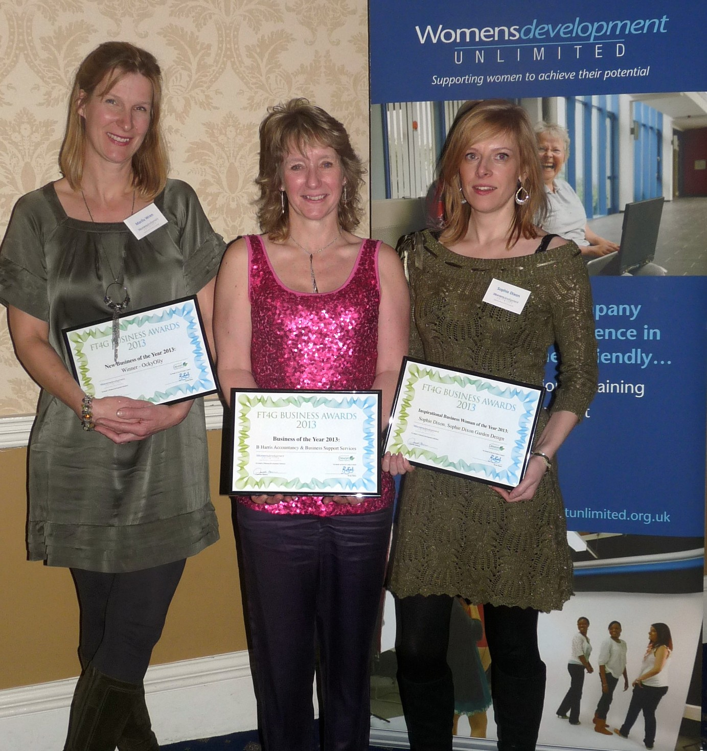 Sophie receiving her award along with two other winners, at the Women's Development Unlimited ceremony and dinner.